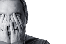 Man with double facepalm
